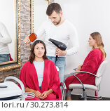 Купить «Professional hairdresser styling and drying hair with fen of woman», фото № 30273814, снято 25 апреля 2018 г. (c) Яков Филимонов / Фотобанк Лори