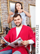 Купить «Cheerful woman professional hairdresser cut male's hair in hairdressing salon», фото № 30273822, снято 25 апреля 2018 г. (c) Яков Филимонов / Фотобанк Лори