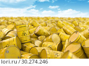 Купить «Storage and utilization of nuclear radioactive waste concept background. Heap of yellow barrels with radioactive sign.», фото № 30274246, снято 24 января 2020 г. (c) Maksym Yemelyanov / Фотобанк Лори