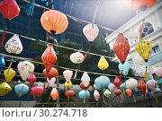Asian city street decorated with traditional multicolored chinese lanterns. Стоковое фото, фотограф Andriy Bezuglov / Фотобанк Лори