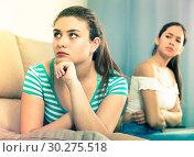 Купить «Two quarreled girls on sofa», фото № 30275518, снято 7 июня 2017 г. (c) Яков Филимонов / Фотобанк Лори