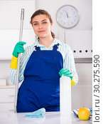 Купить «Woman in uniform is ready to clean the cabinet», фото № 30275590, снято 21 мая 2017 г. (c) Яков Филимонов / Фотобанк Лори