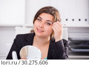 Купить «Female trainee is preparing herself for meeting», фото № 30275606, снято 21 мая 2017 г. (c) Яков Филимонов / Фотобанк Лори
