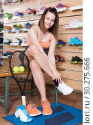 Купить «Girl trying sneakers in sport store», фото № 30275666, снято 15 мая 2017 г. (c) Яков Филимонов / Фотобанк Лори