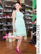 Купить «female is showing summer pink shoes that she chosen in boutique.», фото № 30294570, снято 10 мая 2017 г. (c) Яков Филимонов / Фотобанк Лори