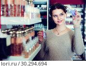 Купить «Young girl customer is searching for strong perfume», фото № 30294694, снято 21 февраля 2017 г. (c) Яков Филимонов / Фотобанк Лори