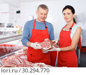 Купить «Adult sellers satisfied of quality meat in shop», фото № 30294770, снято 22 июня 2018 г. (c) Яков Филимонов / Фотобанк Лори