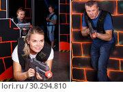 Купить «happy girl with laser pistol playing laser tag with friends», фото № 30294810, снято 3 сентября 2018 г. (c) Яков Филимонов / Фотобанк Лори