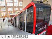 Купить «Funicular Mtatsminda in Tbilisi. Tourists get into the cable car to travel to Mtatsminda mountain or to the Pantheon», фото № 30299622, снято 2 октября 2018 г. (c) Юлия Бабкина / Фотобанк Лори