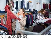 Купить «Women choosing warm coats in boutique», фото № 30299898, снято 6 декабря 2018 г. (c) Яков Филимонов / Фотобанк Лори