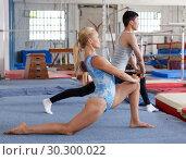 Купить «Happy woman and man acrobats training gymnastic action at gym», фото № 30300022, снято 18 июля 2018 г. (c) Яков Филимонов / Фотобанк Лори