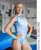 Купить «Positive mature woman acrobat in bodysuit exercising gymnastic action», фото № 30300046, снято 18 июля 2018 г. (c) Яков Филимонов / Фотобанк Лори