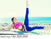 Купить «Female 30-40 years old is practicing yoga», фото № 30300094, снято 6 мая 2017 г. (c) Яков Филимонов / Фотобанк Лори