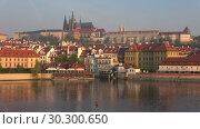 Купить «Вид на старый город ранним апрельским утром. Прага, Чехия», видеоролик № 30300650, снято 22 апреля 2018 г. (c) Виктор Карасев / Фотобанк Лори