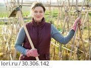 Купить «Female farmer on her plantation», фото № 30306142, снято 21 февраля 2019 г. (c) Яков Филимонов / Фотобанк Лори