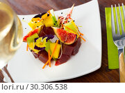 Купить «Raw tuna tartare with cucumber, figs», фото № 30306538, снято 19 марта 2019 г. (c) Яков Филимонов / Фотобанк Лори