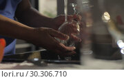 Купить «Woman washing wineglass in the kitchen», видеоролик № 30306710, снято 19 марта 2019 г. (c) Данил Руденко / Фотобанк Лори