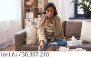 Купить «ill woman measuring temperature by thermometer», видеоролик № 30307210, снято 10 марта 2019 г. (c) Syda Productions / Фотобанк Лори