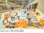 Купить «a large selection of fresh fish lying in the ice on the counter of the supermarket. Text in Russian: salmon, steak, piece, carp, Sylvia, pollock, cod, Atlantic, smelt, herring, trout, sea bass, catfish, Burbot, mackerel, bream, pike, Amur, crucian carp», фото № 30314282, снято 1 марта 2019 г. (c) Акиньшин Владимир / Фотобанк Лори