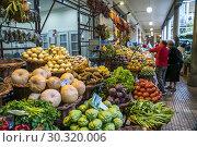 Купить «Fruits and vegetable at the market hall Mercado dos Lavradores, Funchal, Madeira, Portugal, Europe.», фото № 30320006, снято 15 февраля 2019 г. (c) age Fotostock / Фотобанк Лори