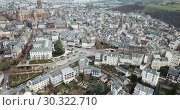 Купить «Aerial view of French city of Rodez with tower of Cathedral and spire of church of Saint Amans in autumn day», видеоролик № 30322710, снято 4 января 2019 г. (c) Яков Филимонов / Фотобанк Лори