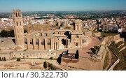 Купить «View from drone of Catalan city of Lleida with medieval Cathedral of St. Mary of La Seu Vella», видеоролик № 30322730, снято 25 июля 2018 г. (c) Яков Филимонов / Фотобанк Лори
