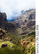 Купить «Fabulous Masca mountain gorge the most visited tourist attraction on Tenerife», фото № 30322898, снято 13 сентября 2015 г. (c) Ирина Мойсеева / Фотобанк Лори