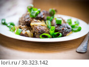 Купить «fried liver with onions in a plate on a wooden», фото № 30323142, снято 16 марта 2019 г. (c) Peredniankina / Фотобанк Лори