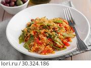 Купить «Bulgur Pilaf with Green Beans and red pepper», фото № 30324186, снято 6 марта 2019 г. (c) Stockphoto / Фотобанк Лори