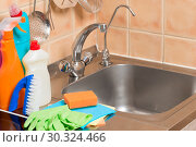 Купить «close-up objects in the kitchen - faucet, sink and cleaning products», фото № 30324466, снято 9 июля 2016 г. (c) Константин Лабунский / Фотобанк Лори
