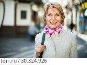 Купить «Portrait of smiling mature blond woman in town», фото № 30324926, снято 22 августа 2019 г. (c) Яков Филимонов / Фотобанк Лори