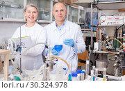 Купить «Confident male and female scientists», фото № 30324978, снято 24 января 2019 г. (c) Яков Филимонов / Фотобанк Лори