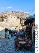 Купить «Mostar old town street with shops and historic architecture. Bosnia and Herzegovina», фото № 30325686, снято 24 февраля 2018 г. (c) Николай Коржов / Фотобанк Лори