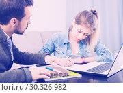 Купить «tutor explaining material to his female client at home», фото № 30326982, снято 4 марта 2017 г. (c) Яков Филимонов / Фотобанк Лори