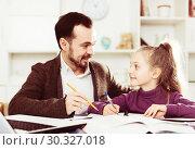 Купить «Father helping daughter with homework», фото № 30327018, снято 27 марта 2019 г. (c) Яков Филимонов / Фотобанк Лори