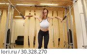 Купить «Athlete smiling woman doing fitness in the gym. Preparing for a hands exercises», видеоролик № 30328270, снято 25 марта 2019 г. (c) Константин Шишкин / Фотобанк Лори