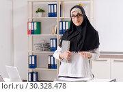 Купить «Female employee in hijab working in the office», фото № 30328478, снято 21 января 2019 г. (c) Elnur / Фотобанк Лори