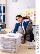 Купить «Young businessman working in the office», фото № 30328698, снято 28 декабря 2018 г. (c) Elnur / Фотобанк Лори