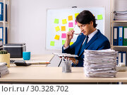 Купить «Young businessman working in the office», фото № 30328702, снято 28 декабря 2018 г. (c) Elnur / Фотобанк Лори