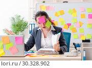 Купить «Young female employee in conflicting priorities concept», фото № 30328902, снято 19 декабря 2018 г. (c) Elnur / Фотобанк Лори
