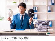 Купить «Male employee in the office in industrial espionage concept», фото № 30329094, снято 7 декабря 2018 г. (c) Elnur / Фотобанк Лори