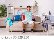 Купить «Young man husband ironing at home», фото № 30329250, снято 4 декабря 2018 г. (c) Elnur / Фотобанк Лори