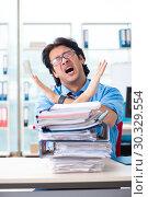 Купить «Handsome businessman unhappy with excessive work in the office», фото № 30329554, снято 19 ноября 2018 г. (c) Elnur / Фотобанк Лори