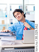 Купить «Handsome businessman unhappy with excessive work in the office», фото № 30329562, снято 19 ноября 2018 г. (c) Elnur / Фотобанк Лори