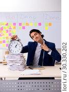 Купить «Young handsome employee in front of whiteboard with to-do list», фото № 30330202, снято 16 октября 2018 г. (c) Elnur / Фотобанк Лори