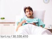 Купить «Young handsome man staying in hospital», фото № 30330410, снято 6 сентября 2018 г. (c) Elnur / Фотобанк Лори