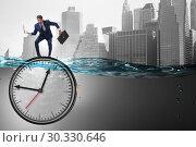 Купить «Businessman in deadline and time management concept», фото № 30330646, снято 19 марта 2019 г. (c) Elnur / Фотобанк Лори