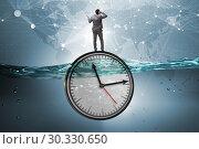 Купить «Businessman in deadline and time management concept», фото № 30330650, снято 19 марта 2019 г. (c) Elnur / Фотобанк Лори