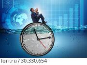 Купить «Businessman in deadline and time management concept», фото № 30330654, снято 19 марта 2019 г. (c) Elnur / Фотобанк Лори