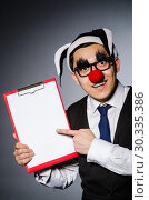 Купить «Funny clown against dark background», фото № 30335386, снято 24 марта 2014 г. (c) Elnur / Фотобанк Лори